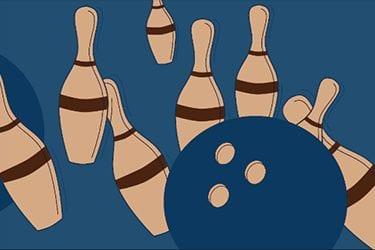 bowling ball striking skittles