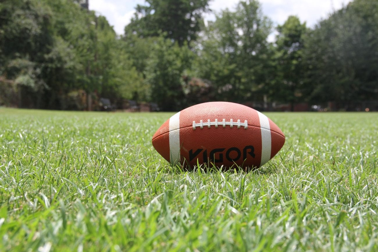american football on grass field